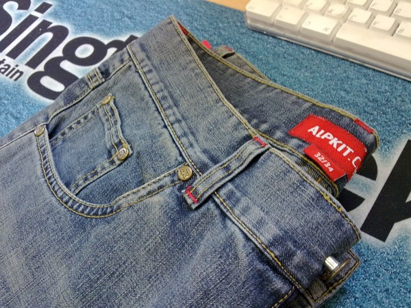 Alpkit's water resistant Jeanius jeans have finally made it into proper production.