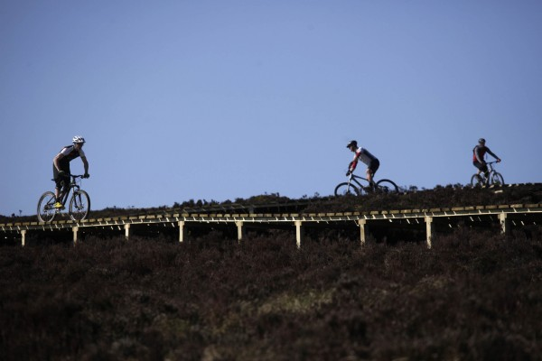 Bikers trying out the red trail in Kielder Water & Forest Park and on the 1.2 kilometre timber `fly-over' - the longest of its kind in England - built to speed riders over boggy terrain. Pic by Mark Pinder.