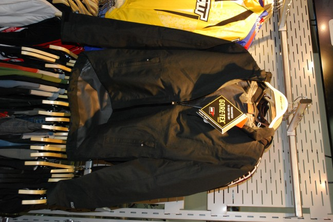 Goretex Paclite jacket. Cycling-cut. Very minimal. We approve. The hood is detachable.