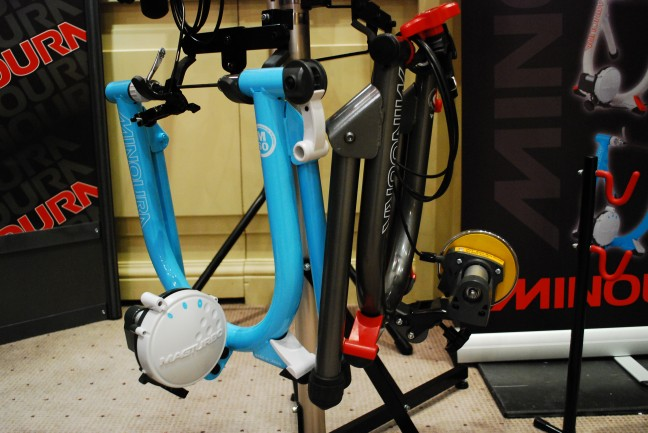 Minoura are trying to de-dullify their turbo trainers by painting them nice colours.